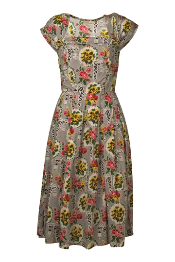 Tea length wedding dresses often give brides a vintage style and feature a skirt that falls below the knee and above the ankle. Tea length dresses come in a variety of fabrics and necklines and can be dressed up or down to fit any type of wedding style.