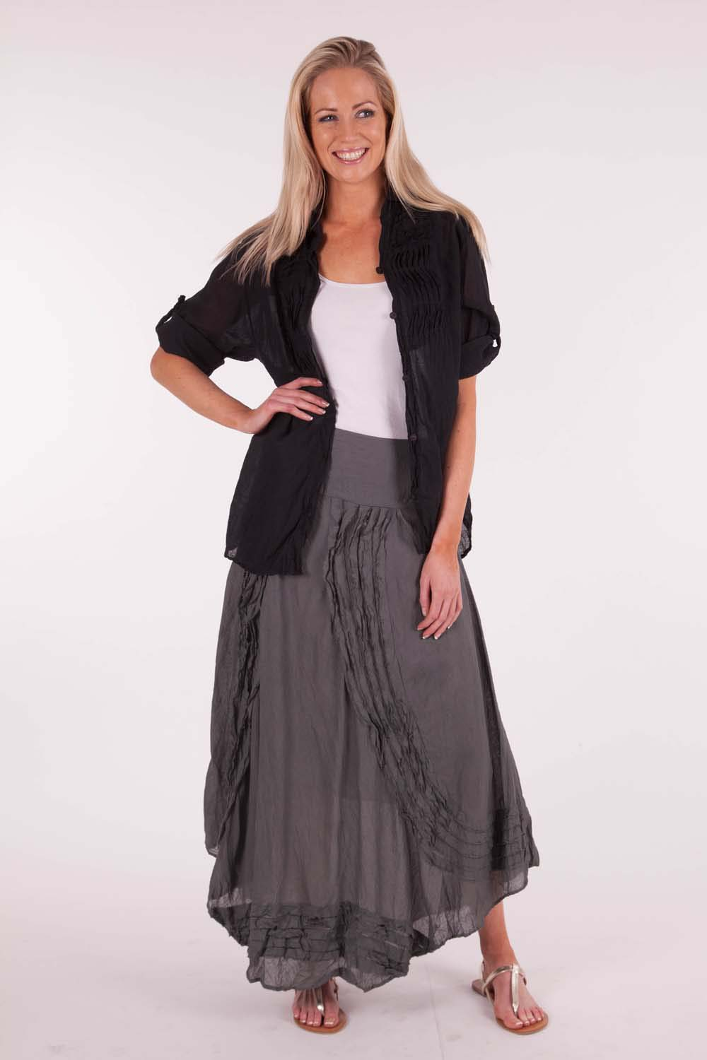It is a long denim skirt in a darker blue color. It has a zip fly and button waist closure. There are 2 pocket in the front and a long slit in the back.